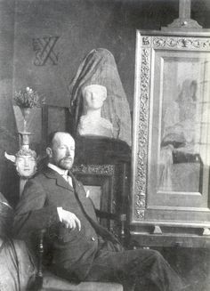 Fernand Khnopff in front of his works.